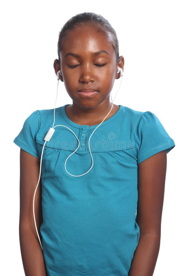 Girl eyes closed earphones in listening to music royalty free stock photos