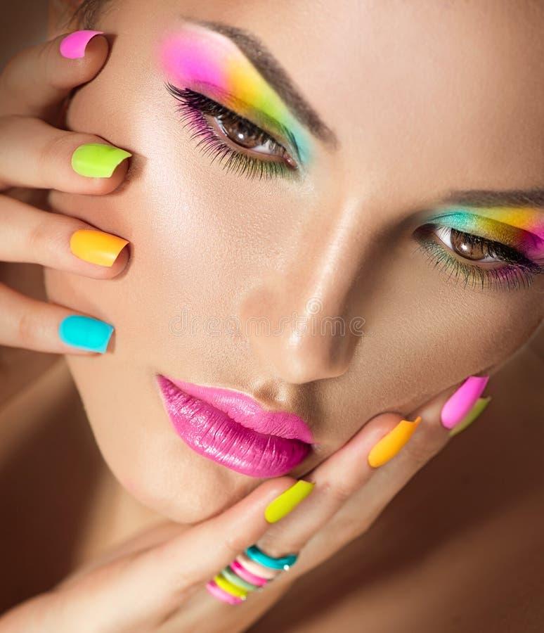 Girl Face With Vivid Makeup And Colorful Nail Polish Stock