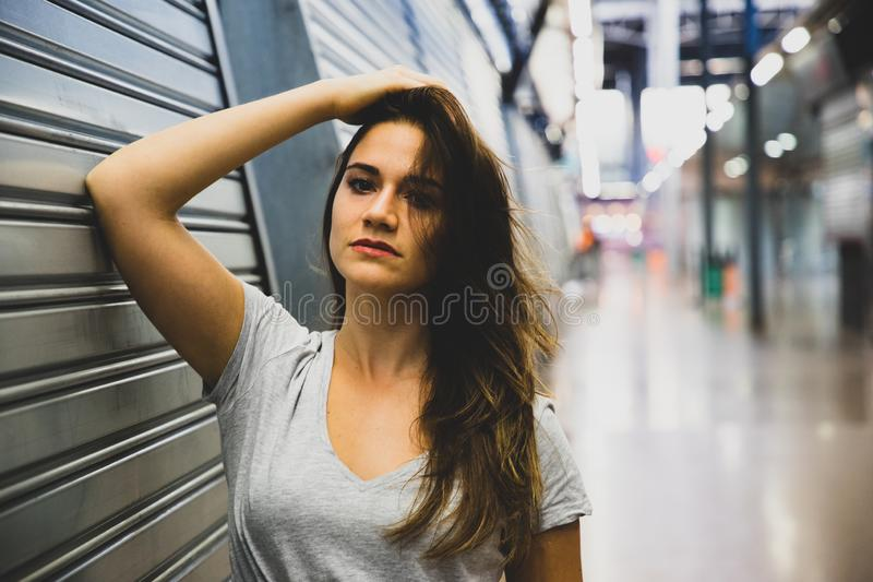Girl in a factory portrait blurred background stock image
