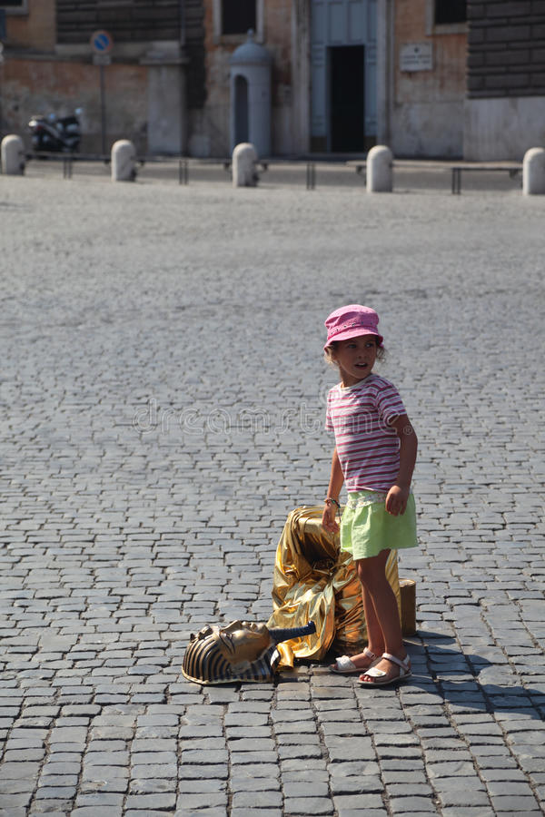 Girl and fake golden mask of pharaoh