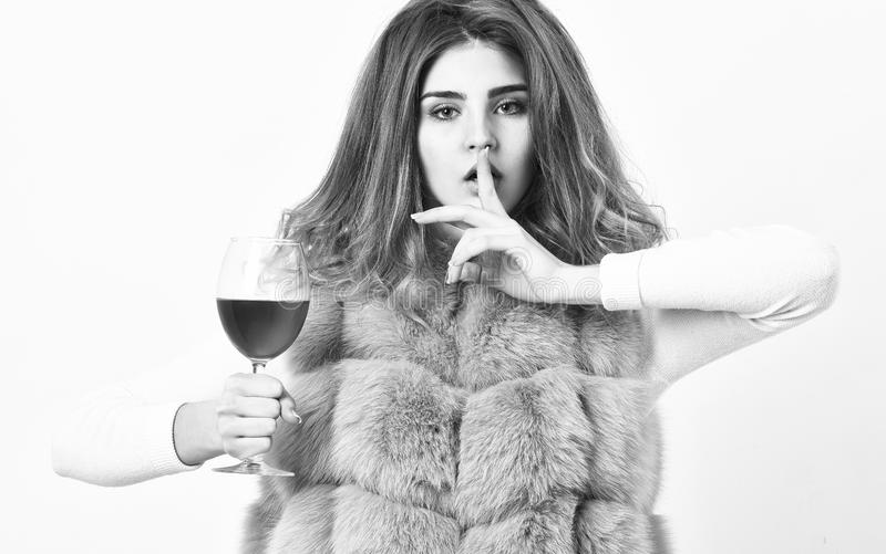 Girl fashion makeup wear fur coat hold wine glass. Alcohol and cold weather. Woman enjoy wine. Hedonism concept. Lady. Curly hairstyle likes expensive luxury stock photography