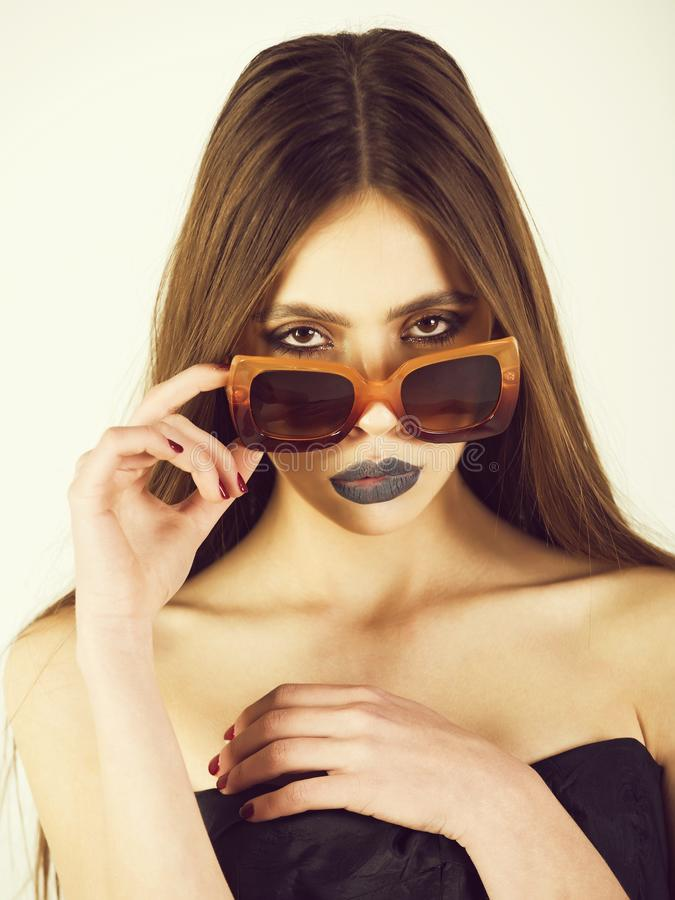 Girl or fashion model portrait, wearing stylish sunglasses royalty free stock images