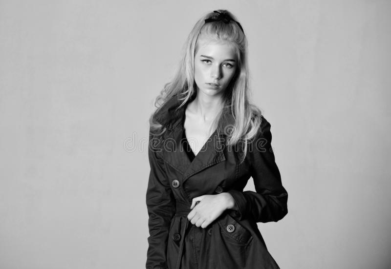 Girl fashion model wear coat for spring and autumn season. Trench coat fashion trend. Must have concept. Fashionable royalty free stock photography