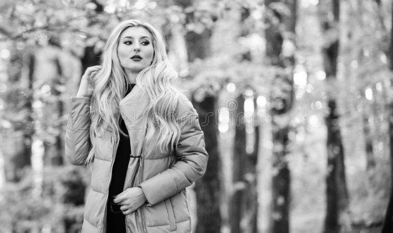 Girl fashionable blonde walk in autumn park. Autumn hair care concept. Autumn hair care is important so as to avoid dry. Frizzy hair. Cold blonde concept. How stock photography