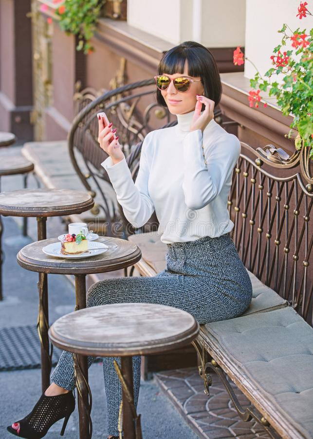 Girl fashionable lady with smartphone. Pleasant time and leisure. Relax and coffee break. Woman attractive elegant royalty free stock photos