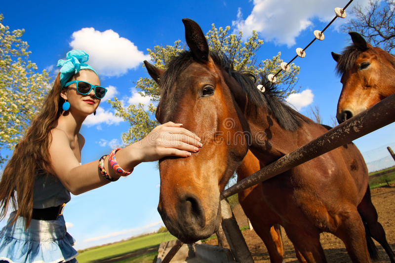 Girl Feeding Her Horses Royalty Free Stock Photos