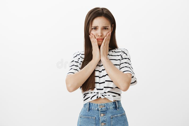 Girl feeling sad of terrible toothache, needing remove wisdom tooth. Portrait of upset worried cute female, squeezing stock image