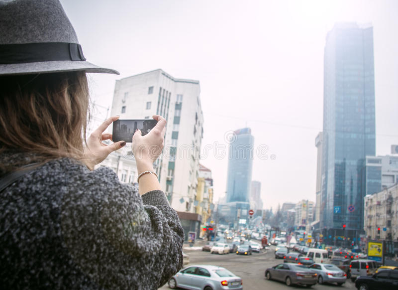 Girl in felt hat, walking around city streets, cloudy day, outdoor royalty free stock photography