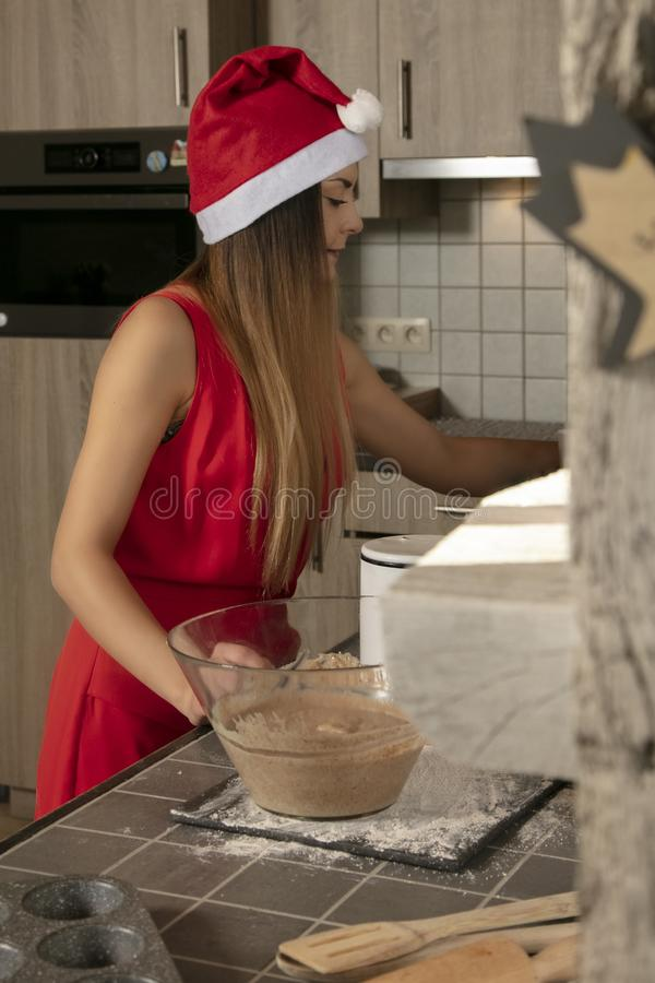 Girl in a festive outfit, prepares a cake for baked goods stock photo
