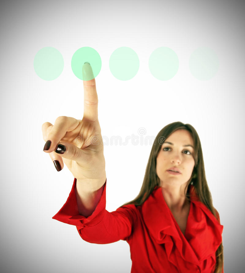 Girl with few green button. Girl in red touch virtual green button finger. Modern technology concept. Business concept royalty free stock image