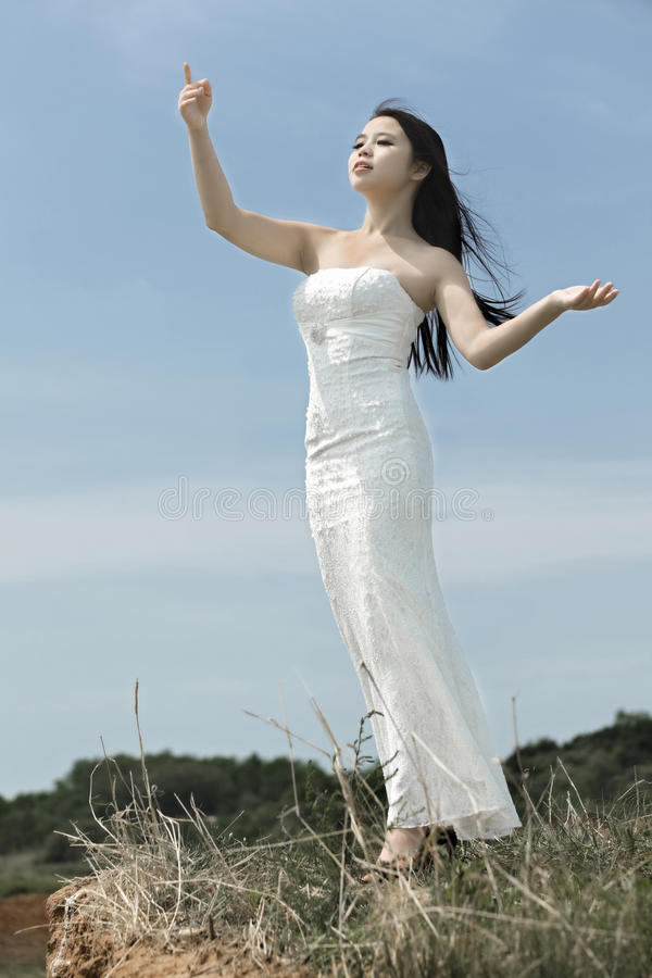 Download A girl in field stock image. Image of dress, asian, upward - 25515317