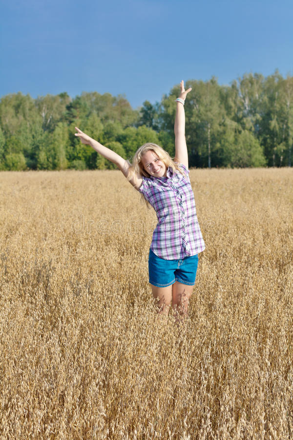 Girl in a field royalty free stock image