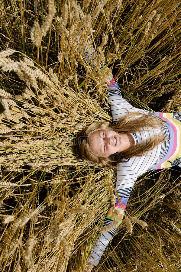 Girl in the field. Happy, laughing girl in a field royalty free stock images