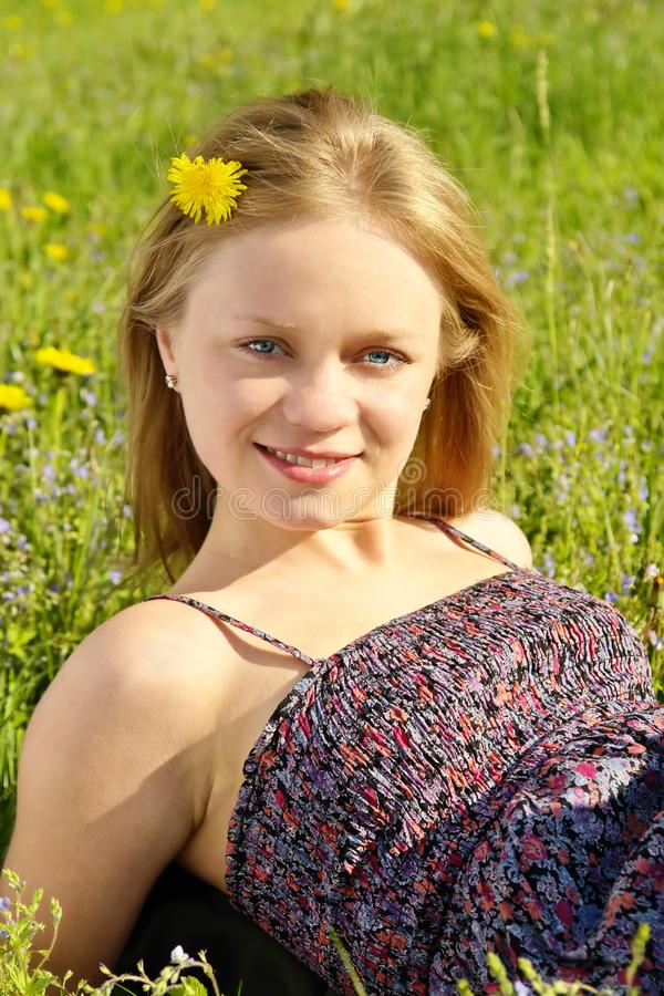 Girl on field stock photo
