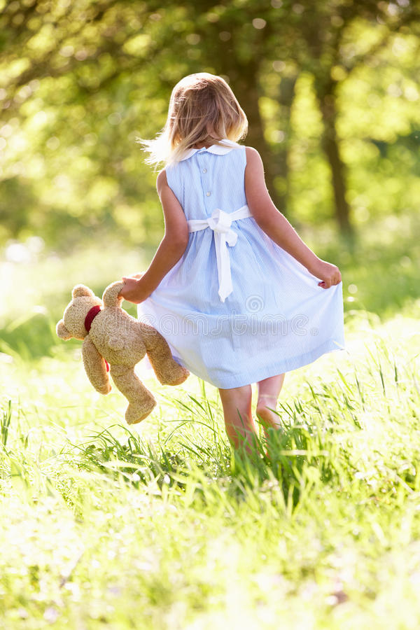 Download Girl In Field Carrying Teddy Bear Stock Image - Image: 26106119