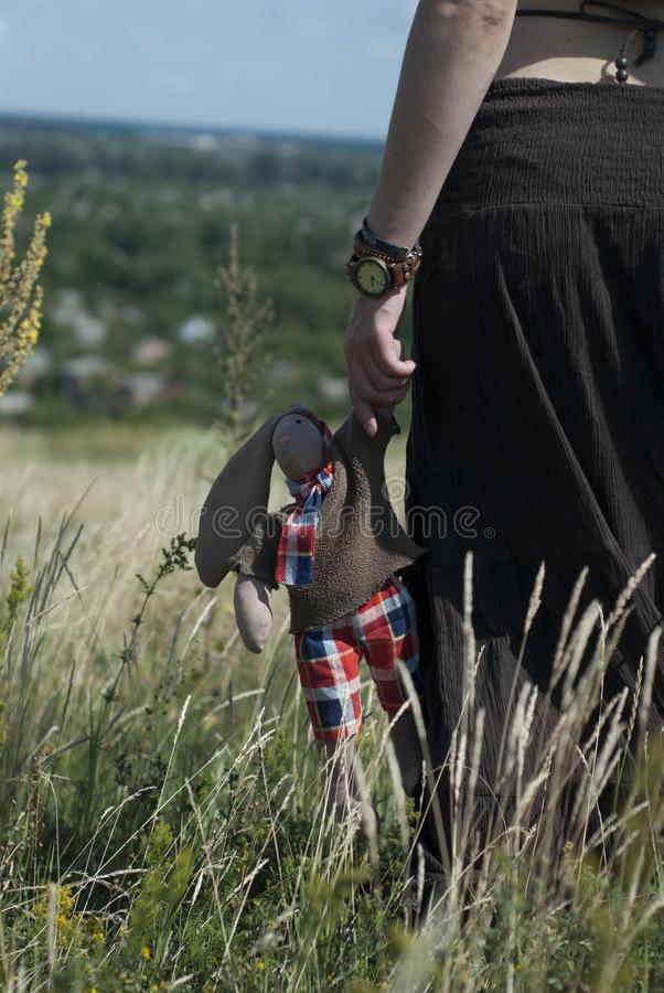 Girl in field keep toy stock images