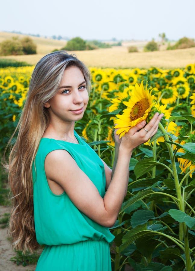 Girl on the field of sunflowers. Beautiful girl on the field of sunflowers stock image