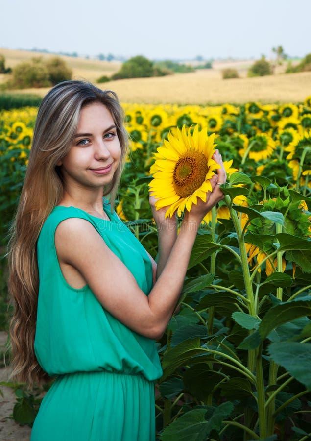 Girl on the field of sunflowers. Beautiful girl on the field of sunflowers stock photography