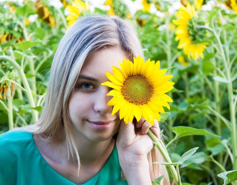 Girl on the field of sunflowers. Beautiful girl on the field of sunflowers stock photo