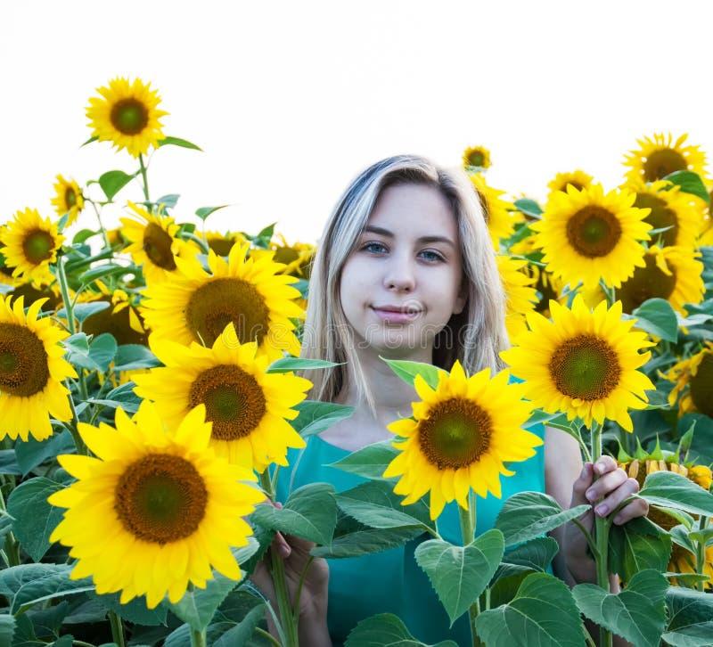 Girl on the field of sunflowers. Beautiful girl on the field of sunflowers stock photos