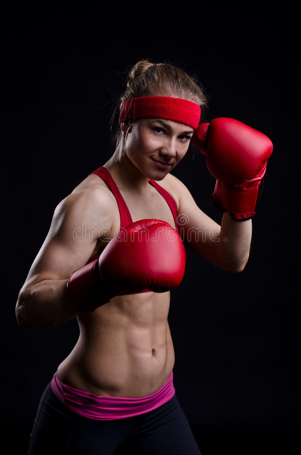 Girl fighter in red gloves royalty free stock images