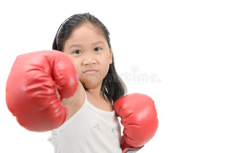 Girl fighting with red boxing gloves isolated. Cute girl fighting with red boxing gloves isolated on white background, exercise and healthy concept stock photo