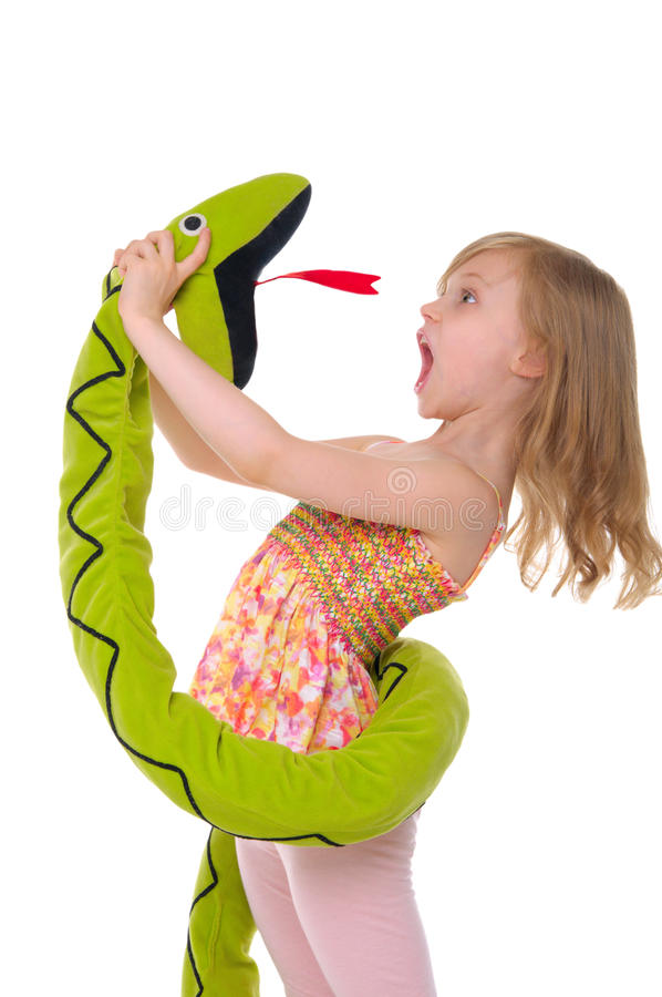 Girl fights with toy snake. Isolated on white stock photo