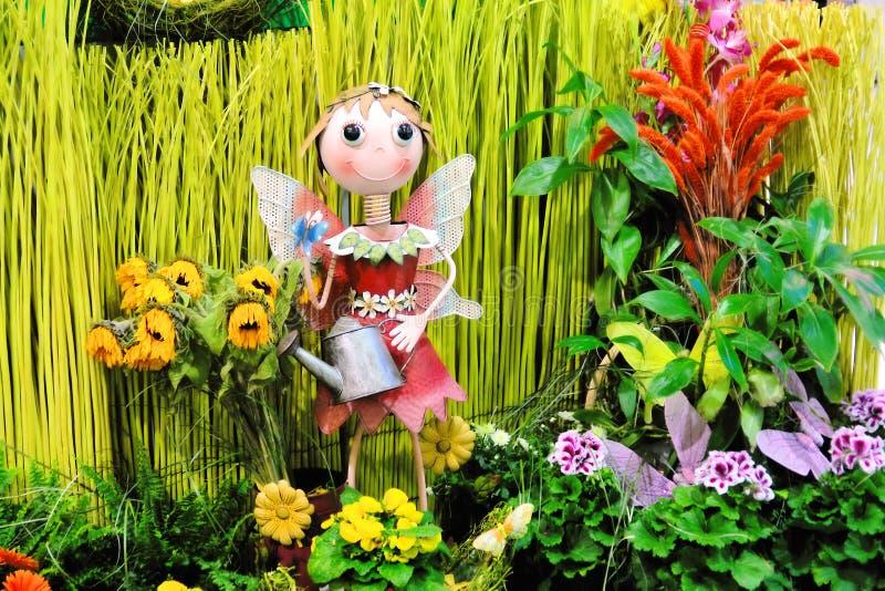 Girl figure in garden stock photos
