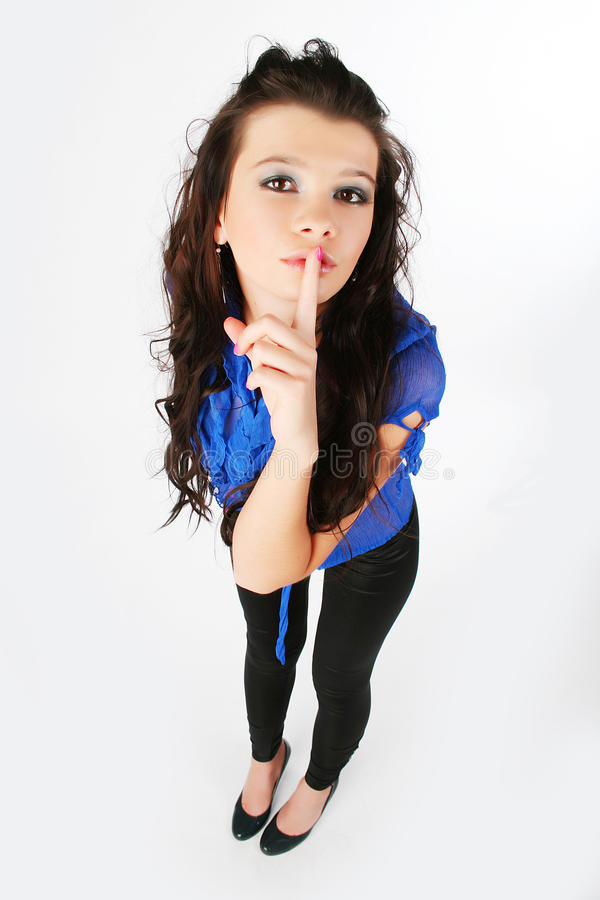 Download Girl Is A Finger To Her Lips Stock Photo - Image: 12843696