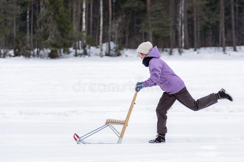 Girl with Finnish sled stock images