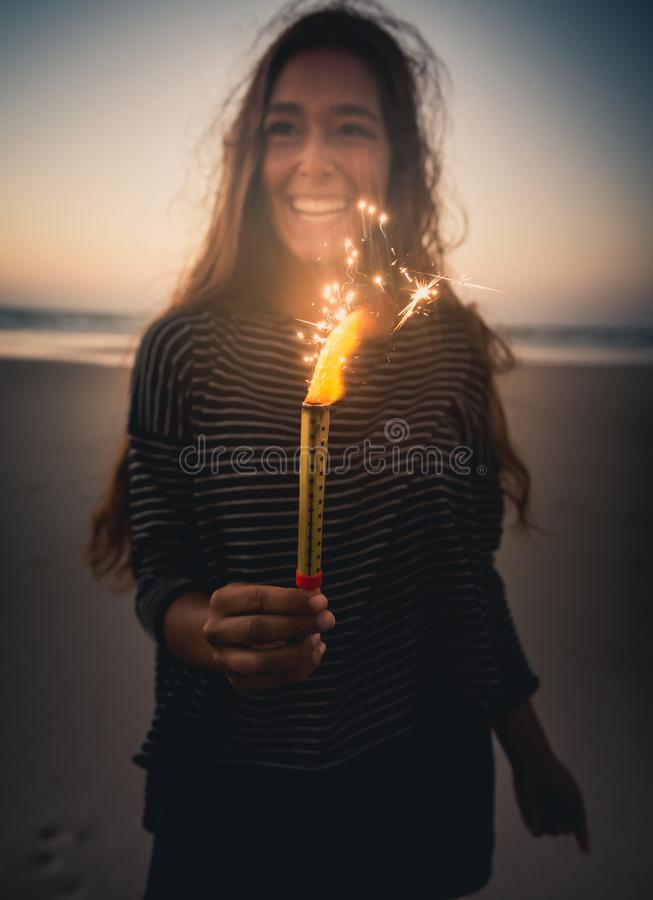 Girl with Fireworks stock photo