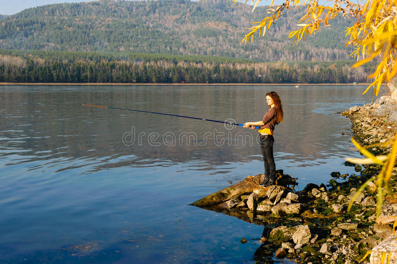 Girl fisherman royalty free stock photography