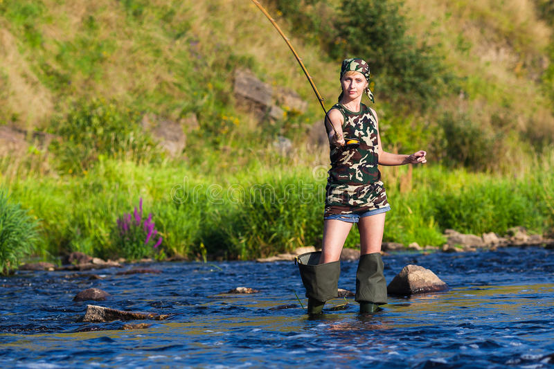 Girl on fishing stock images