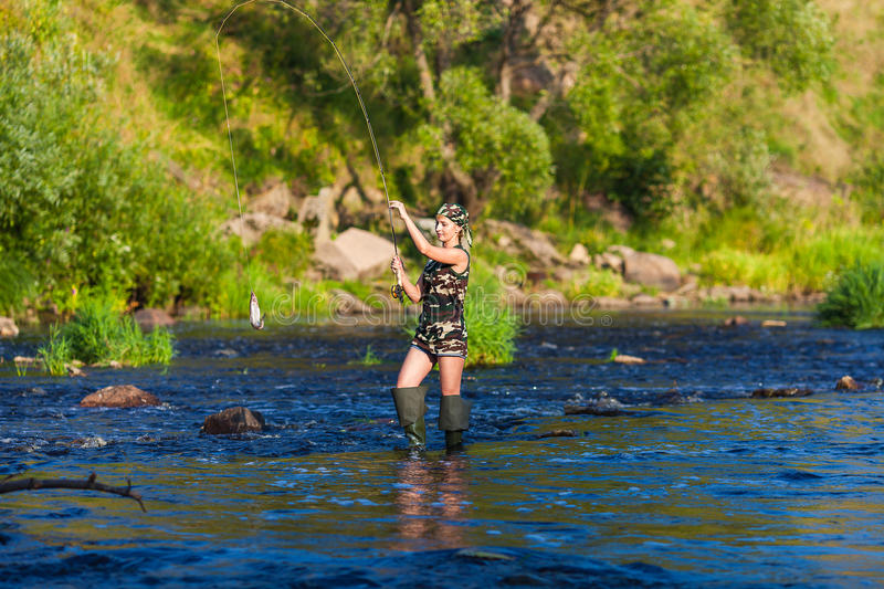 Girl on fishing royalty free stock photography
