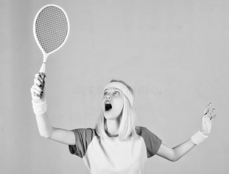 Girl fit slim blonde play tennis. Active lifestyle. Woman hold tennis racket in hand. Tennis club concept. Sport for. Maintaining health. Tennis sport and stock image