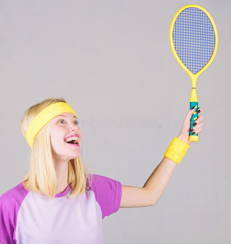 Girl fit slim blonde play tennis. Sport for maintaining health. Active lifestyle. Woman hold tennis racket in hand stock image