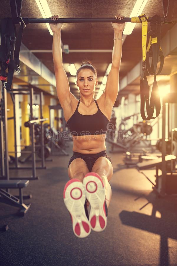 Fitness training on horizontal bar in gym royalty free stock images