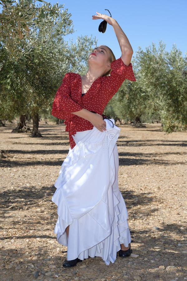 Girl in a flamenco position in an olive grove stock photography