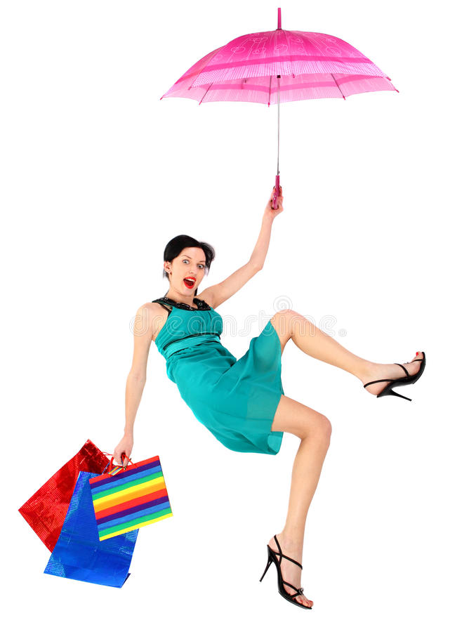 The girl fled on umbrella. The girl fled on an umbrella. Isolated on white background stock photo