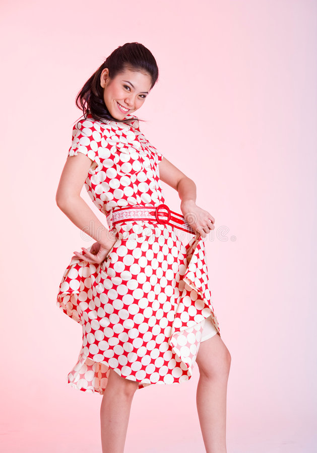 Girl Flipping Dress Royalty Free Stock Photography