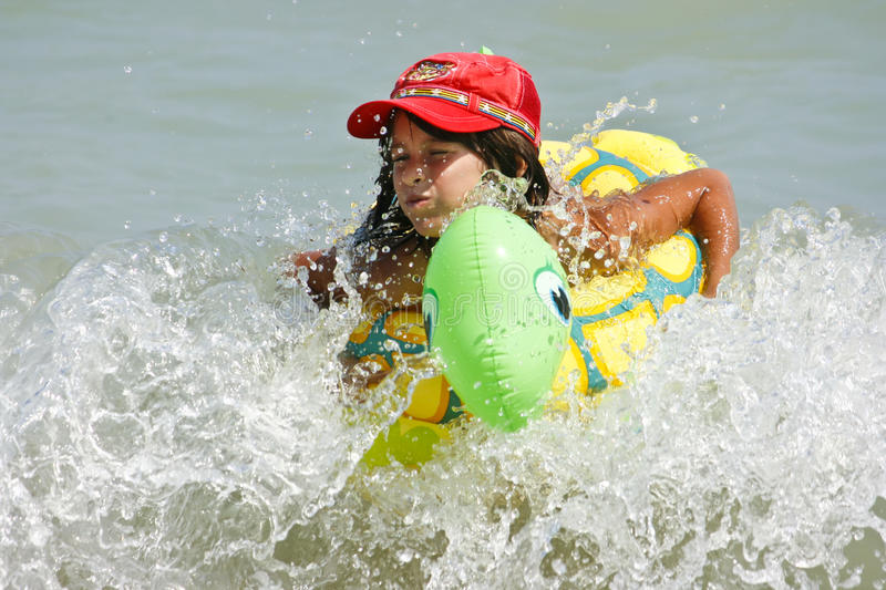 Girl With The Float Stock Photography