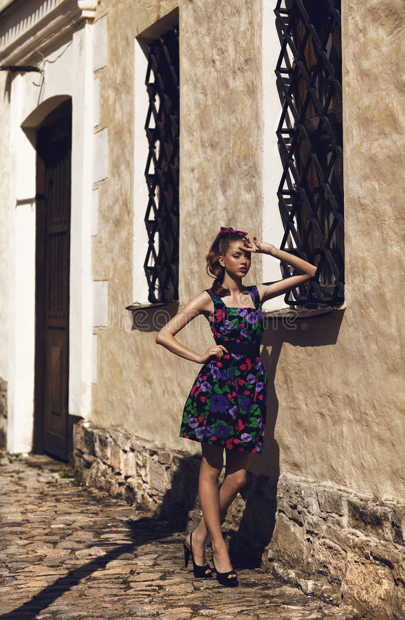 Girl in floral dress posing outside royalty free stock image