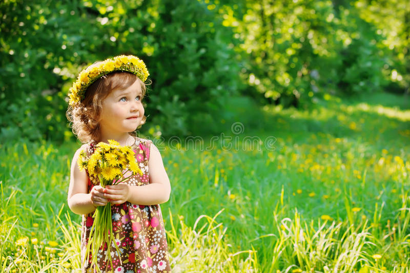 Girl with floral head wreath stock image