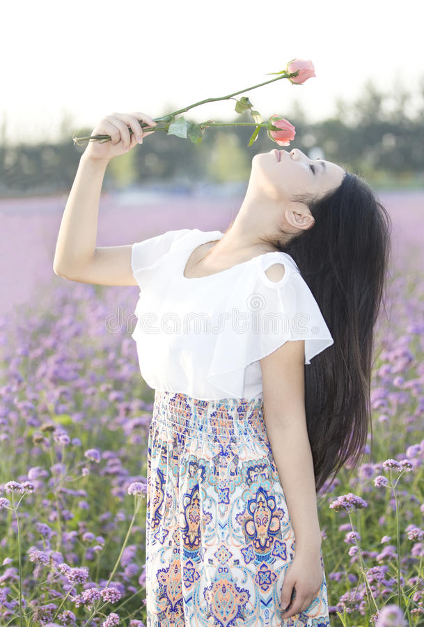 Download A Girl And Flower Stock Photos - Image: 25776533
