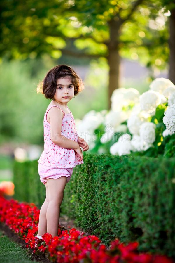 Girl in flower garden royalty free stock photo
