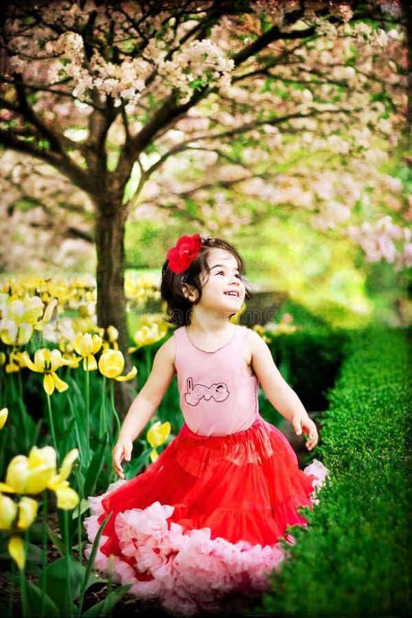 Girl in flower garden stock image