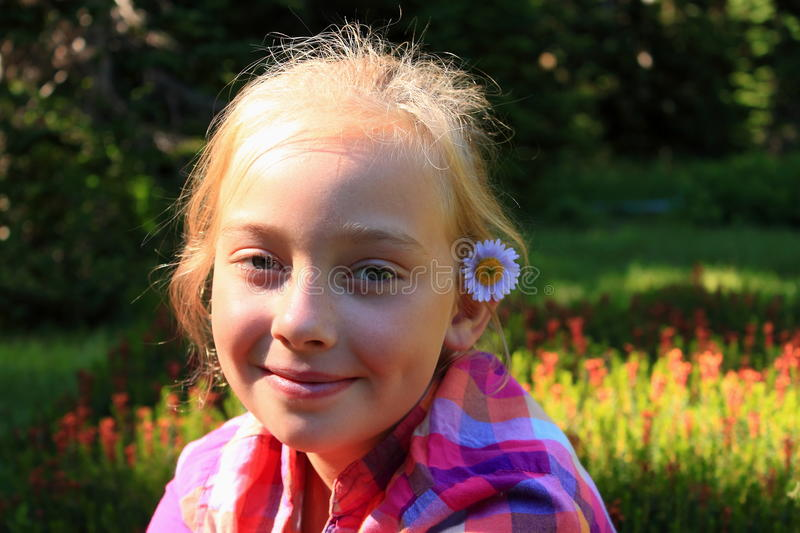 Girl with Flower in her Hair royalty free stock photo