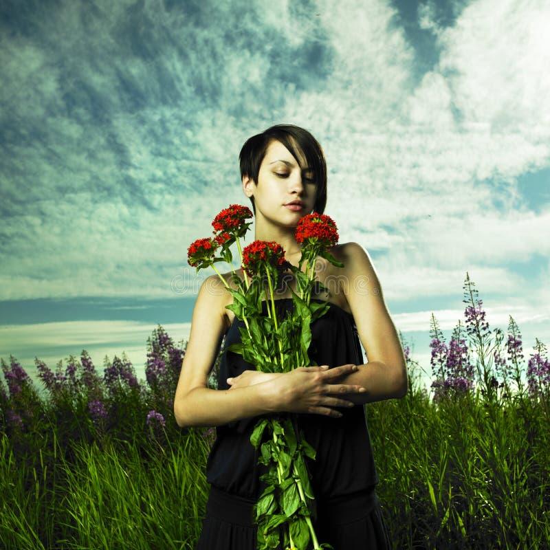 Girl in flower meadow stock image