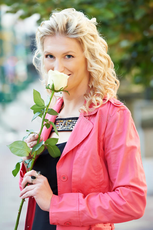 Girl with flower outdoors stock images
