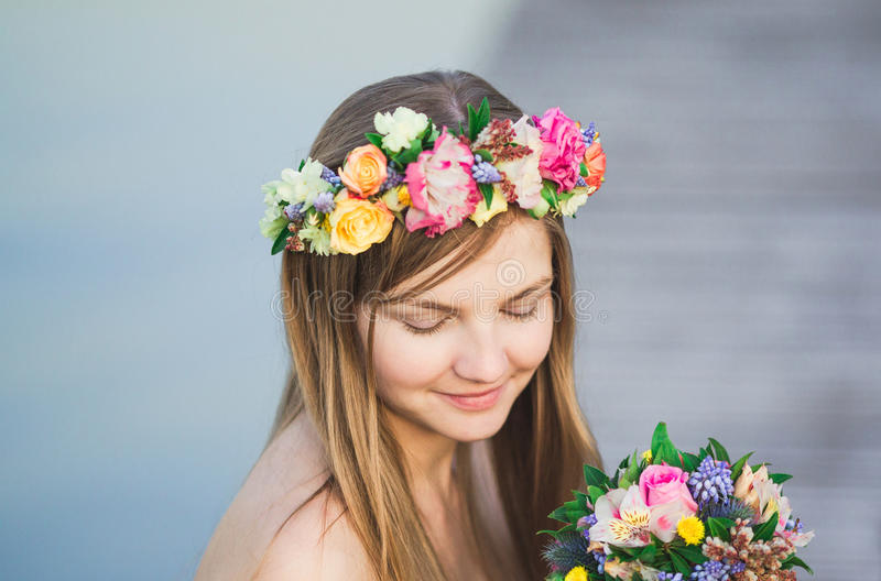Girl and flower wreath stock photo